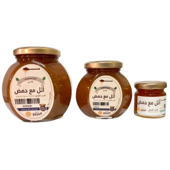 عسل اثل مع حمض.